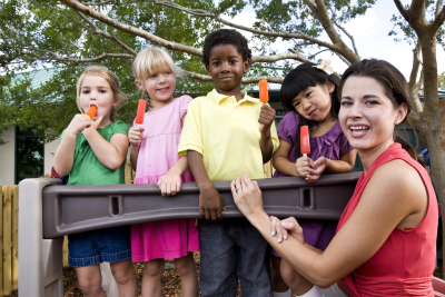 group of preschool playing in daycare with teacher