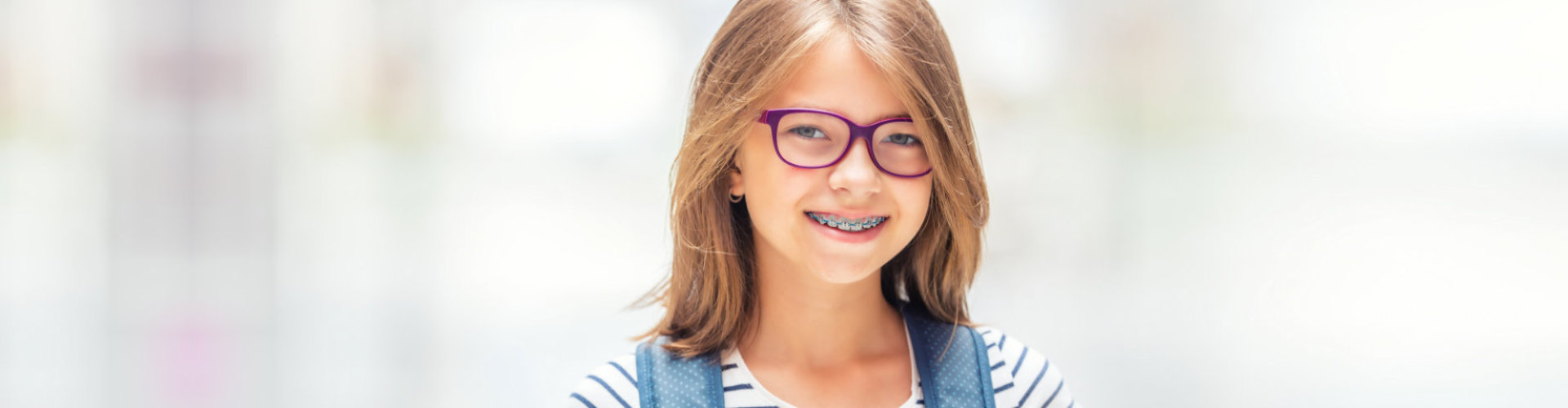 smiling girl wearing eye glasses